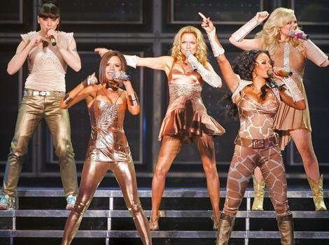 The Spice Girls perform the first concert of the UK leg of their world tour.